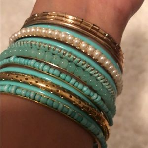 Also gold with turquoise bangle bracelets